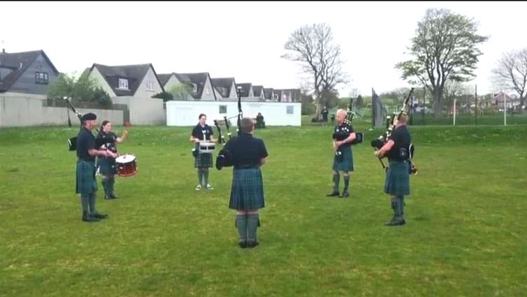 VE celebrations - group playing bagpipes